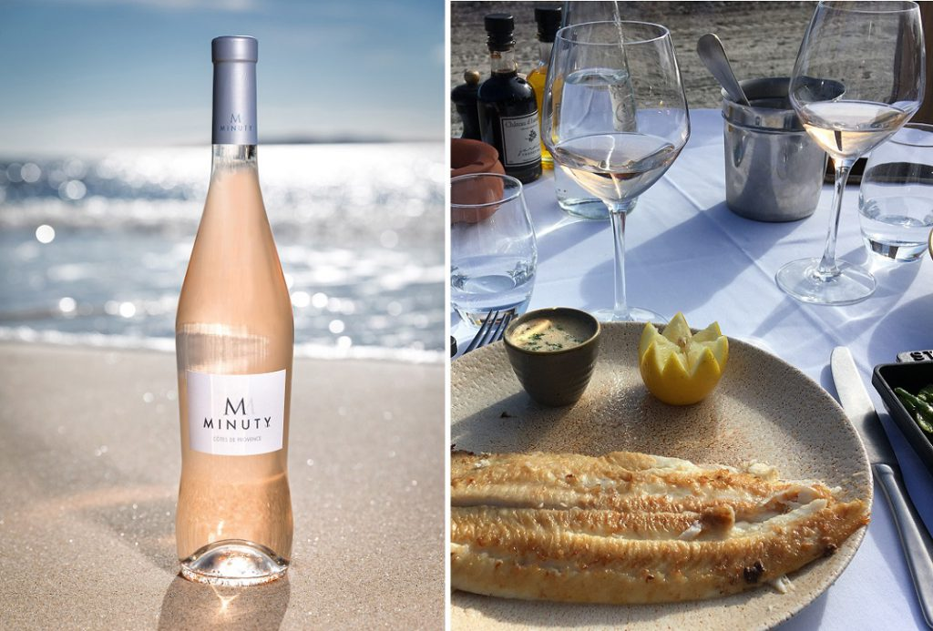 砂浜に置かれたエム・ド・ミニュティーのワインボトル、お魚料理